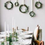 Новогодние украшения 2019: венки на стене у стола